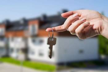 Woman's hand holding keys to new house